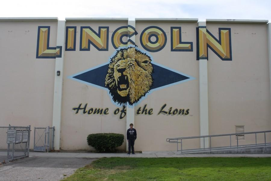 Till Kleinert in front of the Lincoln High school gym