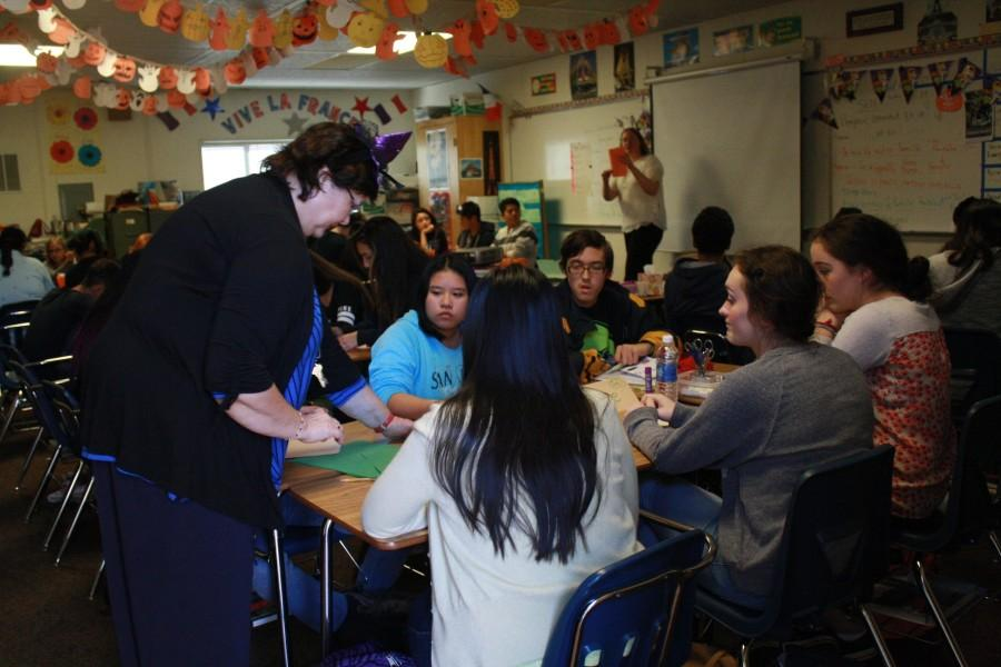 Madame Barbu helps her students prepare for their presentations. ( F. Ramirez / Lion Tales )