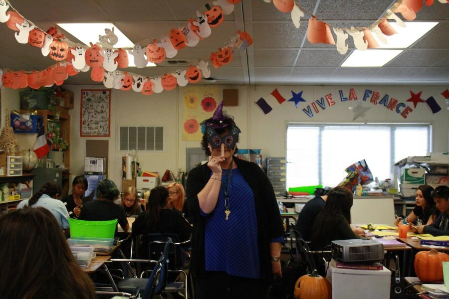 Madame Barbu shows off a completed Halloween mask. ( F. Ramirez / Lion Tales )