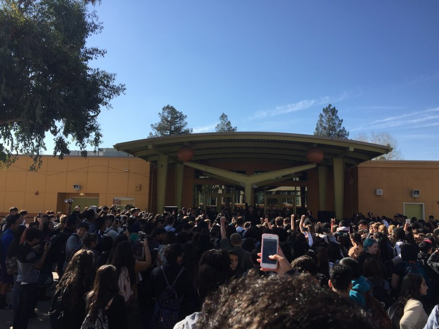 Students walkout to protest election results at Lincoln High School in San Jose, California on November 9, 2016. Students hold up a fist together to show unification. (Brandon Sullivan/ Lincoln Lion Tales)