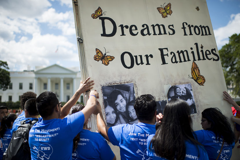 UNITED STATES - JULY 28: Immigration reform protesters with United We Dream erect a giant story book in front of the White House to illustrate the stories of immigrant families on Monday July 28, 2014. (Photo By Bill Clark/CQ Roll Call)