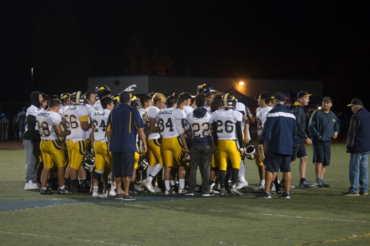 The lions look onto the field as the clock winds down on their first win of the season (Isaiah Velasquez/Lincoln Lion Tales)
