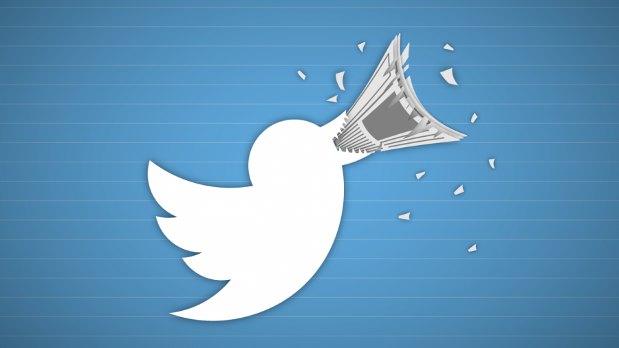The+Twitter+bird+logo+shredding+a+newspaper+in+his+beak.+