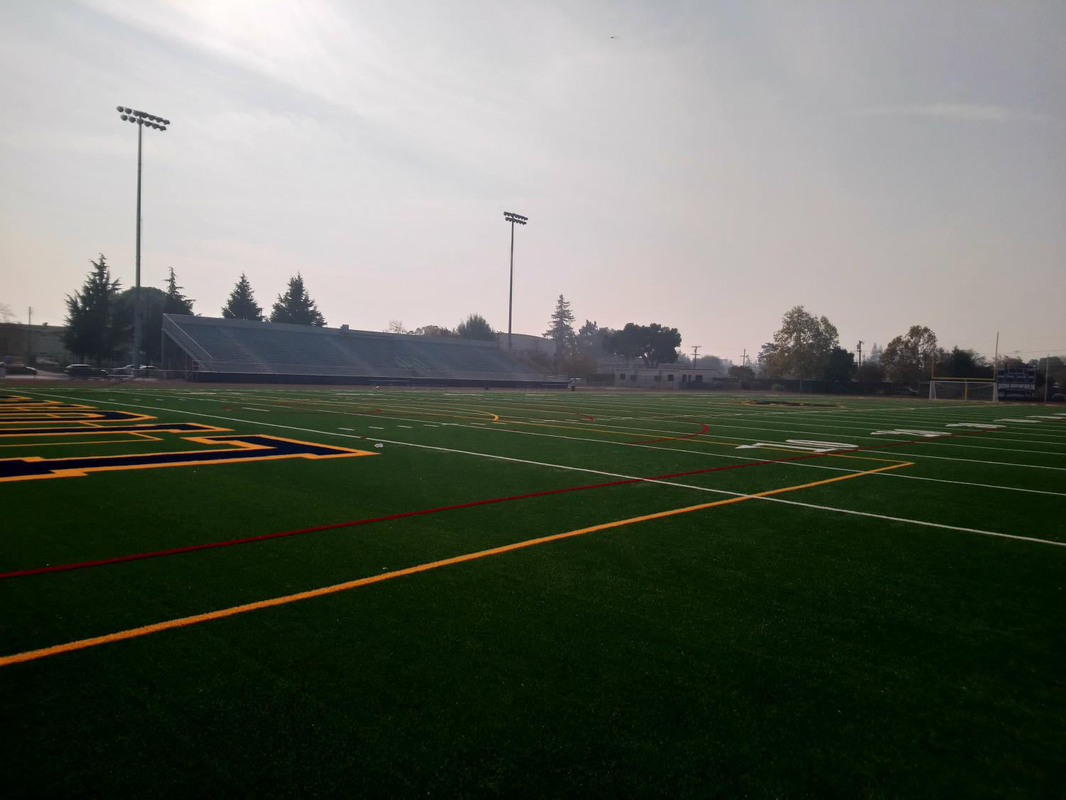 The Lincoln High School field with smoke in the air.