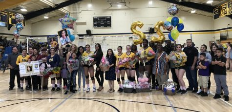 Left to right, Dani Najera, Stephanie Torres, Elva Mendoza, MIchelle Te, Stella Thomas, Asia Burns and Gemma Garcia pose with their families October 24, 2018. (Ariana Noble / Lion Tales)