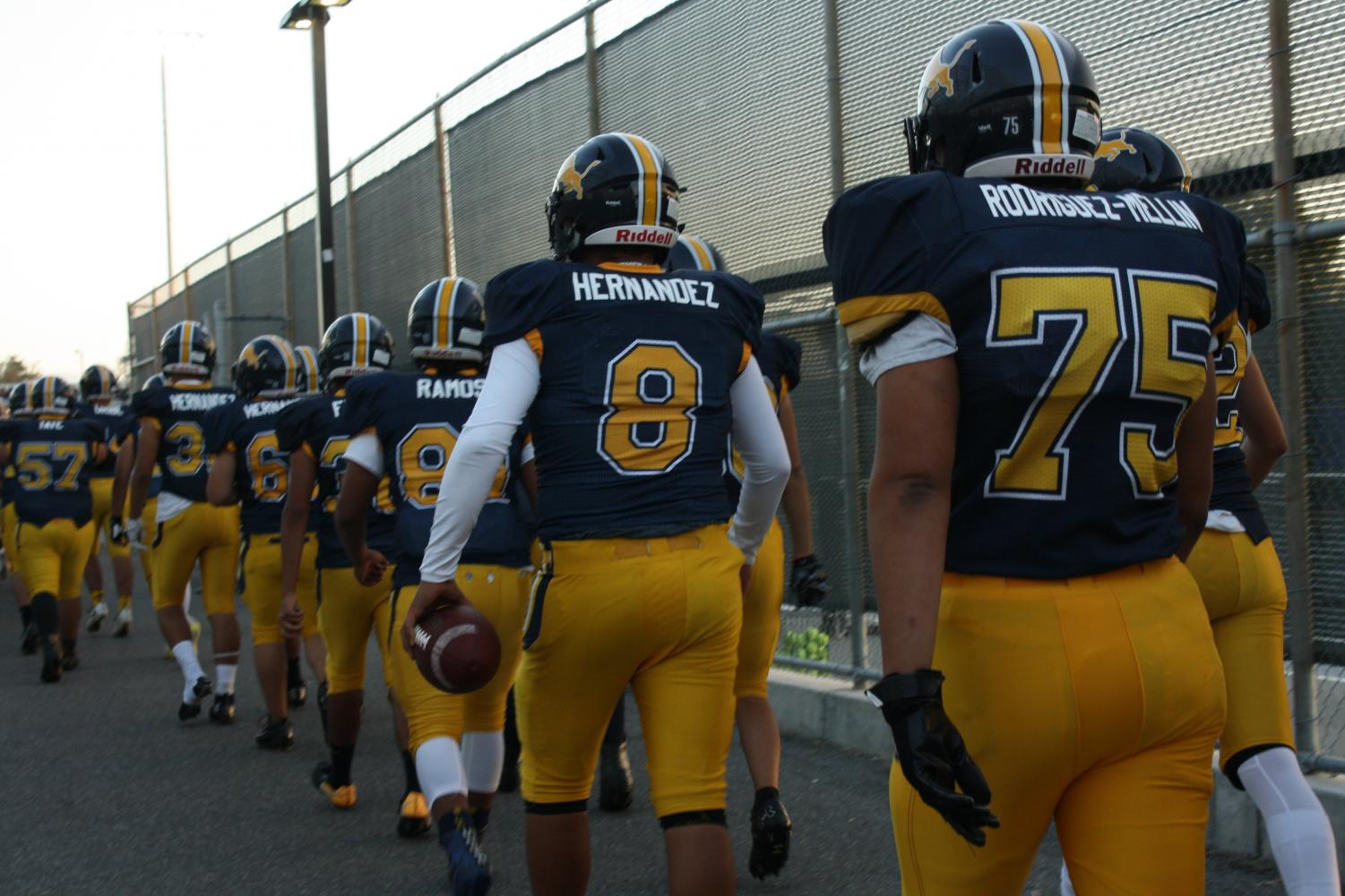 Markus Hernandez #8 walking out with the team. On Friday October 12th the Lions went against the Santa Teresa Saints. Lions won final score 19-13. (Anastasia Cervantes / Lincoln Lion Tales)