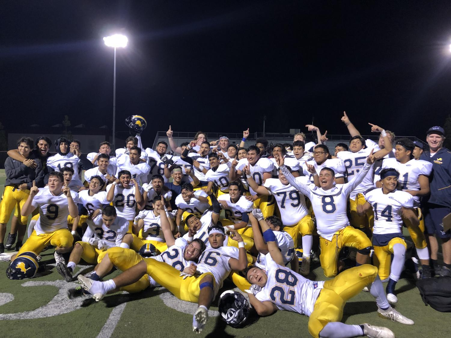 Lincoln Lions smiling for team picture. On Friday the 2nd Lincoln's Football varsity team went up against Piedmont Hills . The final score was Pirates 21- Lions 48 (Anastasia Cervantes / Lincoln Lion Tales)