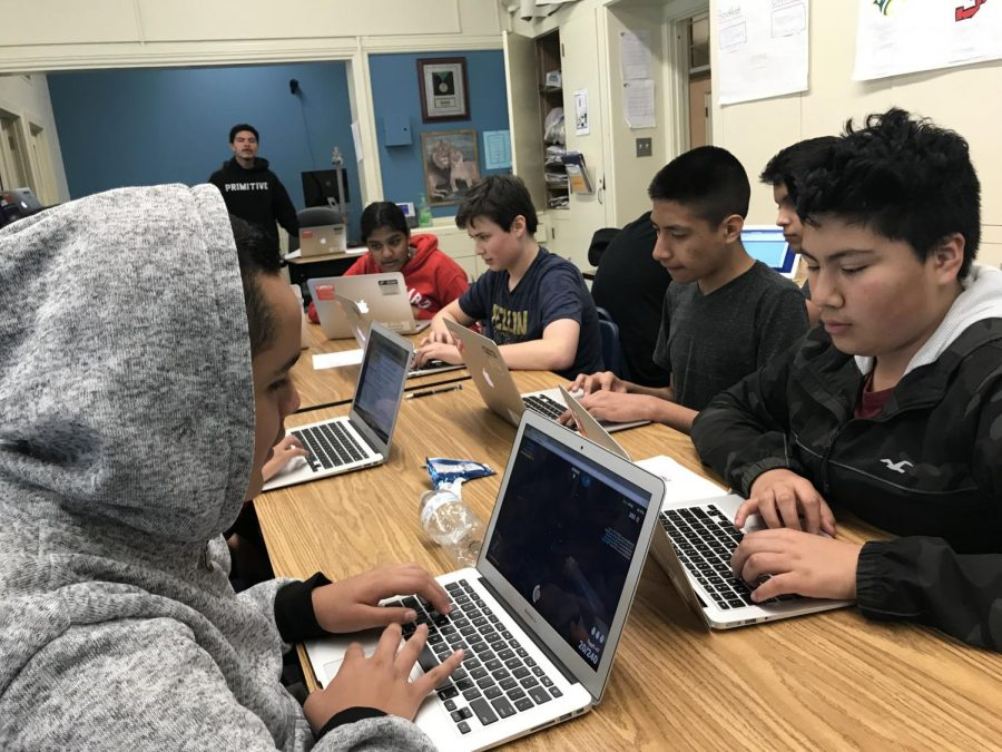 students+help+each+other+to+understand+the+code+to+make+a+website+or+a+simple+game