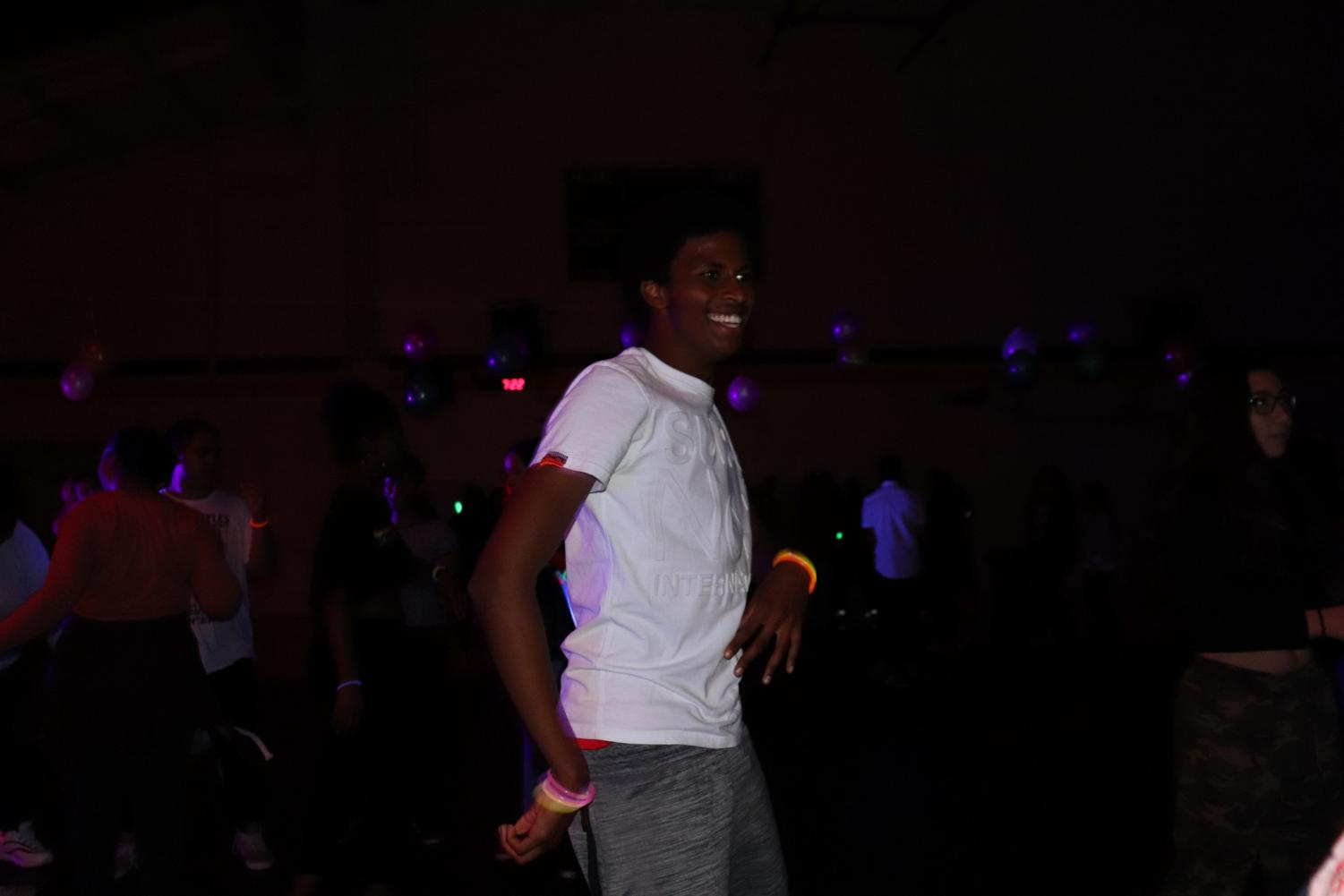 Ilyass Sugal busting some moves. He attended the Glow Up Dance (Yearbook for Lincoln Lion Tales).