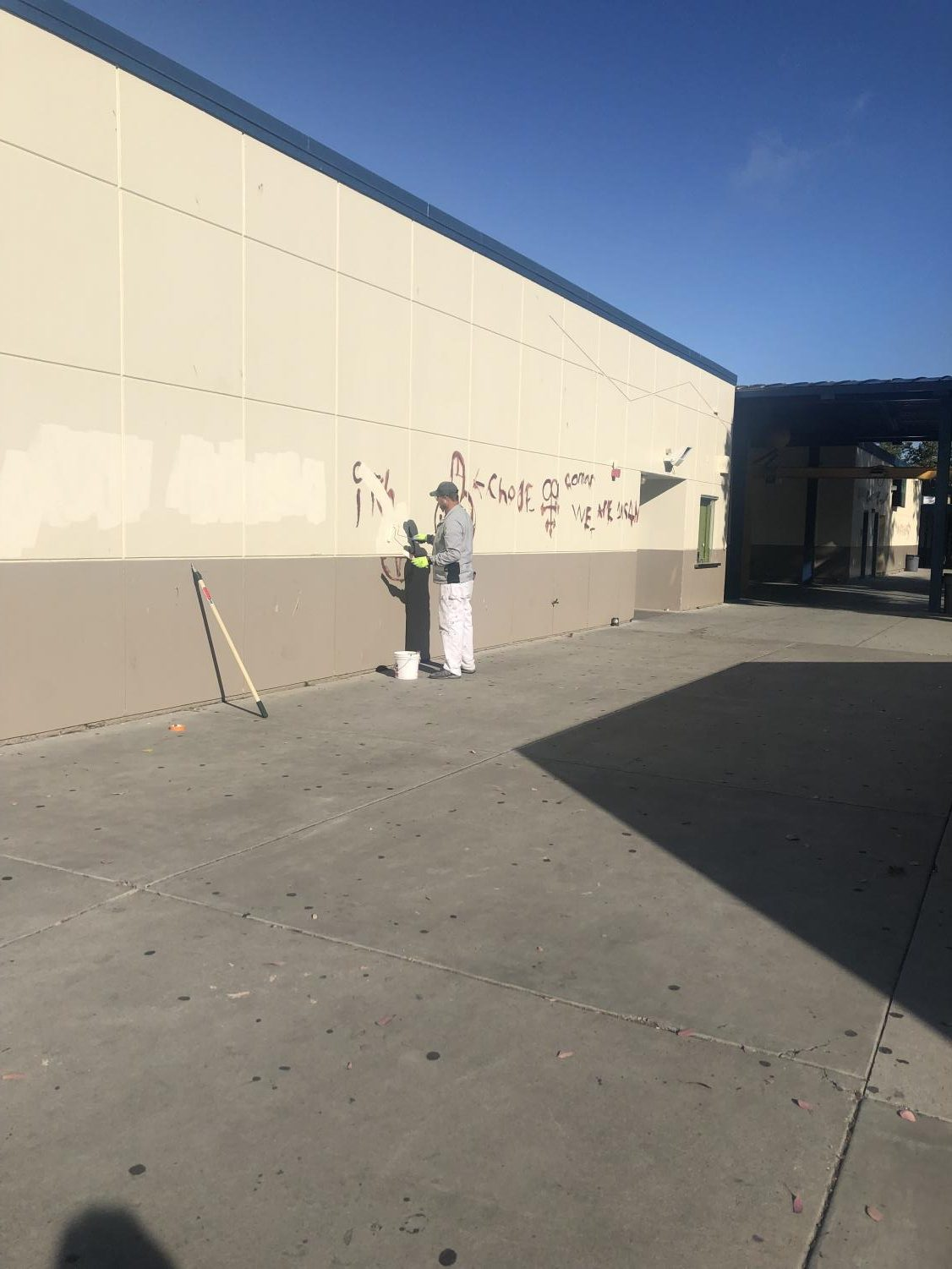 workers painting the wall to hide the crude messages and images on June 6th, 2019. (Nick Bernwanger Lincoln Lion Tales)