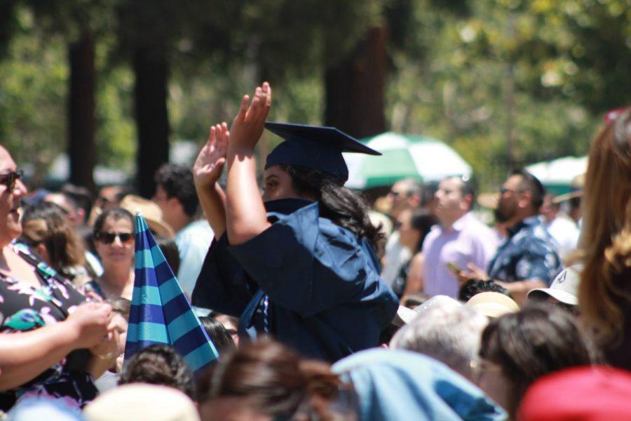 Graduate+waving+%28Anjanai+Vallez%2FLincoln+Lion+Tales%29.+