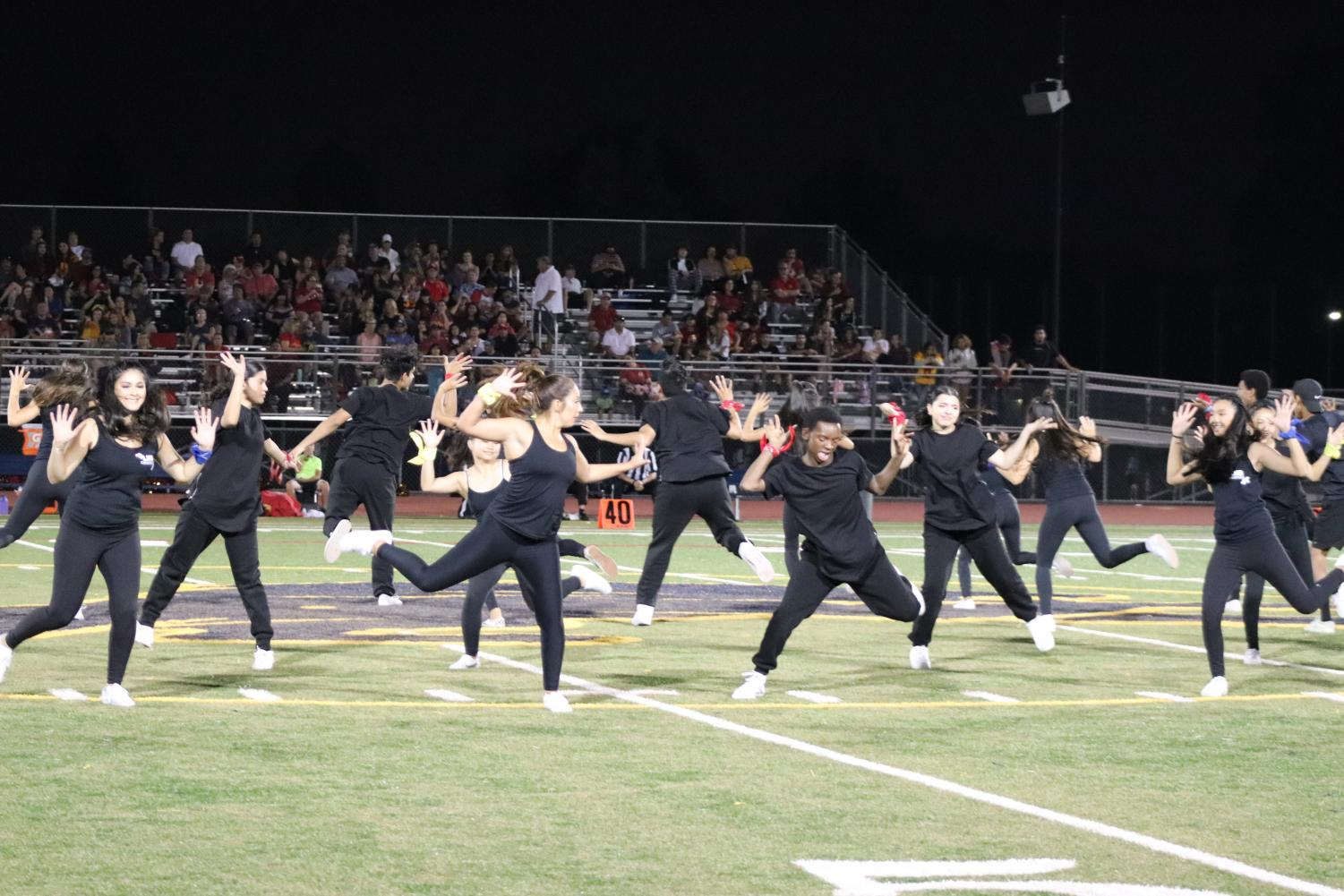Dancers surprising the audience with their jumps. The Lincoln Convertibles and Lincoln Performance Company were dancing halftime with special guest: Willow Glen High School. September 13, 2019 at the Lincoln Football Field (Emilia Kendrick/Lion Tales)