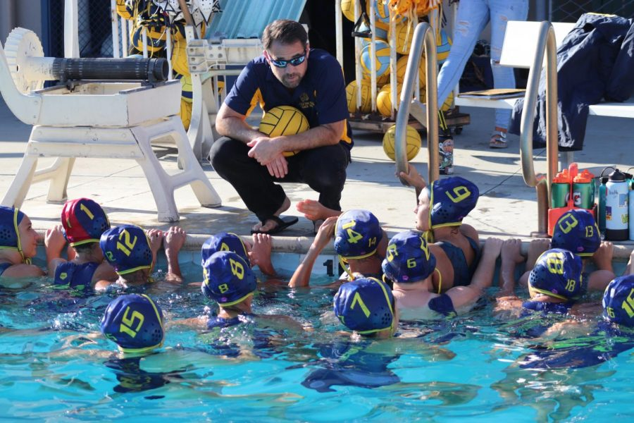 Team+huddling+up+for+a+pep+talk.+The+girls+water+polo+coach+is+Mr.+Resz%2C+the+former+media+arts+teacher+at+Lincoln+High+School.+September+19%2C+2019+at+the+Lincoln+pool+%28Andrea+Saldana%2FLion+Tales%29.