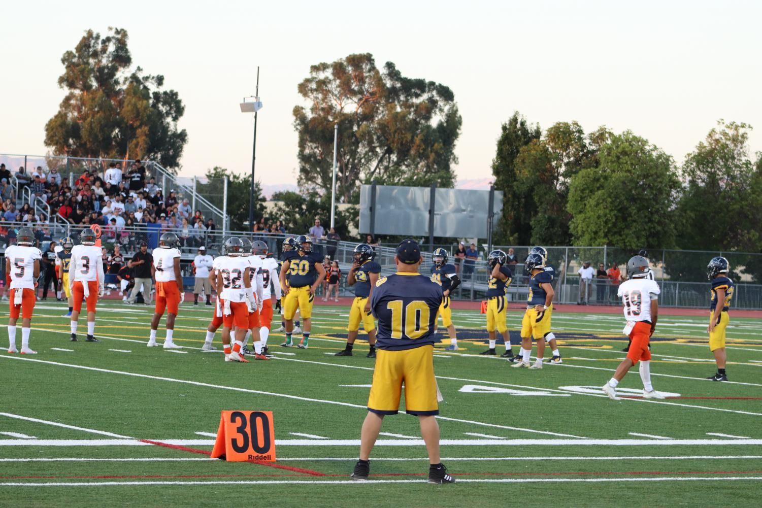 Players lining up the 40 yard mark. It was an intense game between the Lions and the Raiders. The game took place at the Lincoln football field on Friday, August 30, 2019. (Jetzemani Diaz Villalobos--Lion Tales)