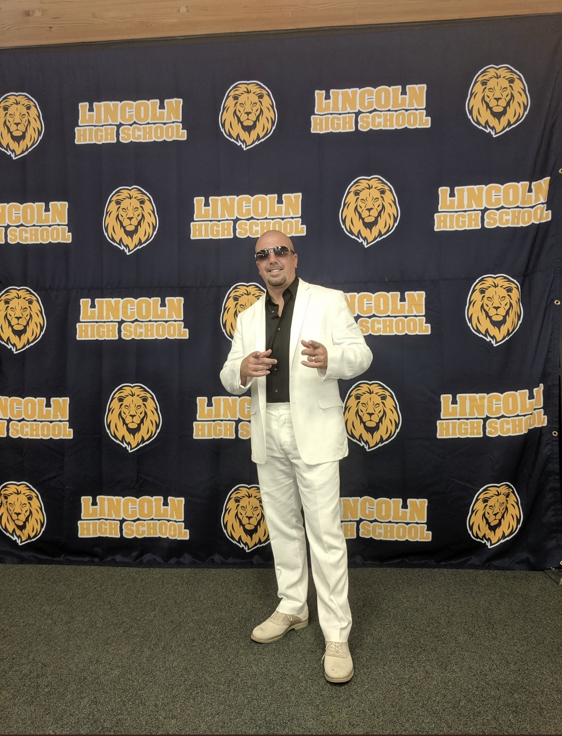 Señor Luz dressed up as music artist Pitbull for school rally!