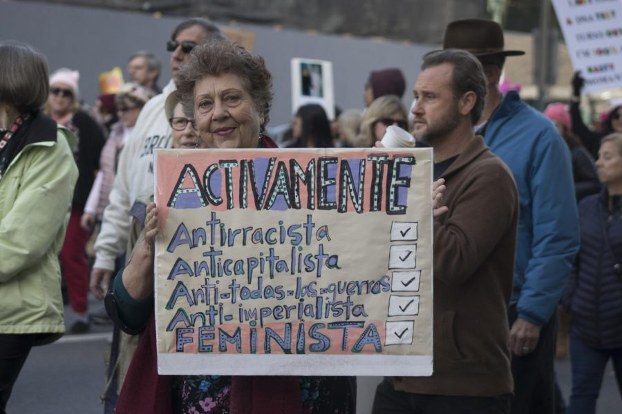 Women+posing+with+her+sign+at+the+2020+womens+march+%28Anjanai+Vallez%2FLion+Tales%29