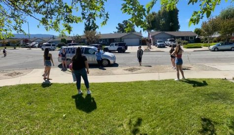 Teammates surprising friend on her birthday by driving by and spray painting a car, all while respecting social distancing protocols (Ariana Noble/Lion Tales)